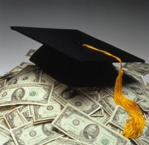 graduation student hat on money