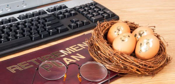 Retirement.IRA.401k.pension.plan.book.and.nest.egg.with.computer use