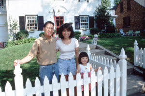 Asian Family in Front of House