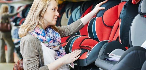 bigstock-woman-choosing-child-car-seat-60877457